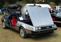 A working DeLorean DMC-12 coupé with open doors and red leather seats in a show of interesting cars in Canada