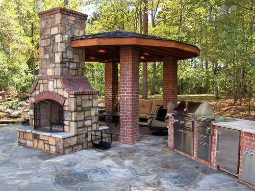 Outdoor fireplace kitchen by ARNOLD Masonry and Concrete